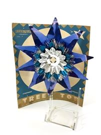 """Vintage early 1940s Doubl-Glo colored tin tree topper in the original packaging. Blue on silver aluminum. 7 1/2"""" across and 7 1/2"""" tall. Has a spot to insert your own vintage light bulb to light it up!"""