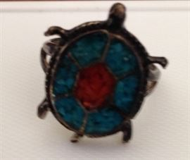 Sorry for the poor picture! Turquoise and probably sterling ladies ring.