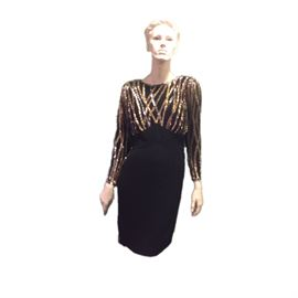 Size: 8  Bob Mackie black cocktail dress with black, silver and gold beading. 100% silk lining.