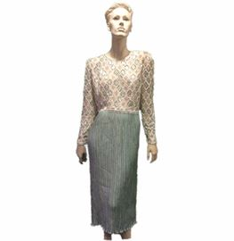 Size: 8 (est.)  Mary McFadden beaded and sequin top over acquamarine pleated skirt.