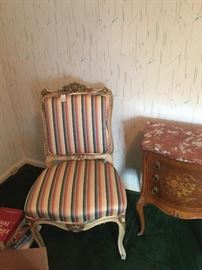 One of a pair of old French side chairs with striped upholstery.