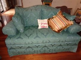 "Teal and greenish Baker couch with 6 throw pillows -Comes with 6 throw pillows: 1 striped colorful, 4 greenish teal, 1 ""A house is a house but mom makes it a home"" 70""W x 39""D x 36""H Matches #171"