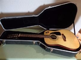 Fender guitar and black fender hard case  Good shape! Fender light and dark wood acoustic guitar  Black fender hard case