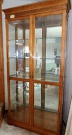 """Beautiful solid oak wood and glass hutch -5 shelves -Lighted -Unique door -Comes with key to unlock and lock -Lighter wood color 39""""W x 13""""D x 82""""H"""