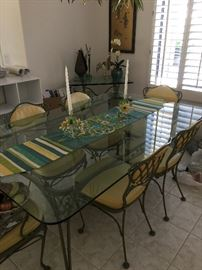 Vintage style dining room table with 2 captain chairs and 4 straight back chairs, wrought iron