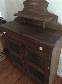 vintage wooden cabinet with perforated metal doors