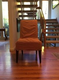 6 red and tan striped slip covered dining chairs. ($450)