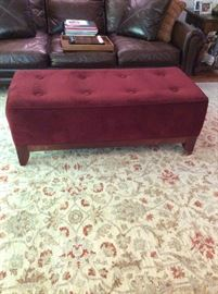 Cranberry colored velvet foot rest/bench. Measures 51 inches long x 23 inches wide x 18 inches tall. ($500)