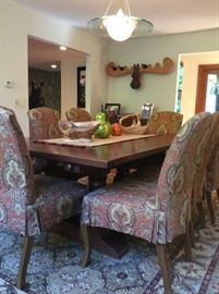Cherry dining table with 8 upholstered chairs. Includes 2 leafs. ($3000)