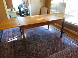 Danish mid century modern dining table with pull out leaves.