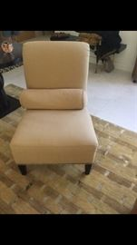 Gorgeous slipper chair with rolled back by Barbara Barry