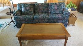 Floral sofa  $75  NOW  $37 Wood cocktail table  $25  NOW $12