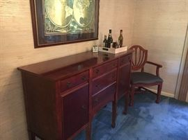 Sideboard/buffet - small (narrow) enough to fit just about anywhere - very versatile piece of furniture.
