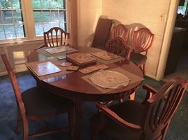Great casual dining room table with upholstered chairs. In solid shape - has a leave that extends the table to accommodate many more people.
