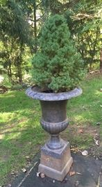 Antique cast iron urn with stand