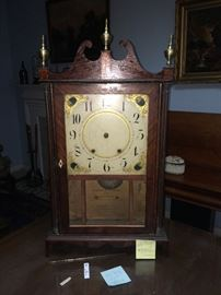 This is an Eli terry clock from 1820 with original wooden works, face and minor case repair.
