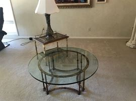 Vintage heavy glass coffee and end table with brass base.