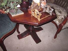 Wood carved octagonal pedestal table.