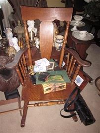 Antique rocking arm chair.
