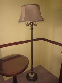 Candlestick brass lamps with fabric shade.