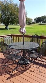 Wrought Iron w/ 4 chairs and umbrella