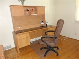 Office desk with plenty of drawer space and chair
