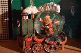 Lots of Santa and Christmas Snow Globes