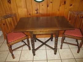 Vintage gang table with matching chairs.