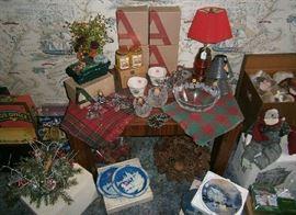 Christmas merchandise including vintage centerpieces, Lenox Christmas bowls, decorative plates, Avon potpourri, and more.