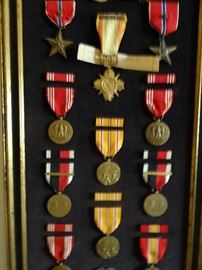 Selection of war medals to include a Vietnam and WW2.  We also have others in boxes.
