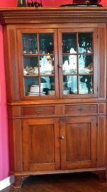 Early 19th century Federal style cherry and pine corner cabinet. Most of the paned glass is original.