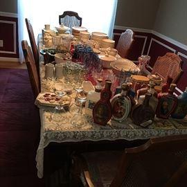 collectors' liquor bottles, china set, glassware, table linen, etc.