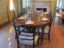 Stunning antique dining room table with (8) chairs.