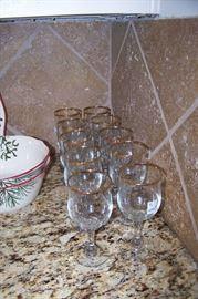 Pretty wine glasses with gold trim
