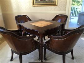 Fabulous game table with 4 leather chairs.
