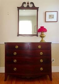 Early 19th C Mahogany Bow Front Chest Of Drawers, Semi-Antique Mirror, Vintage Brass Oil Lamp with Red Shade (Electric, Chimney Intact)
