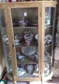Twin antiqued curio cabinets