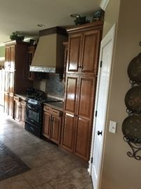 Beautiful custom made kitchen cabinets, build in stove and hood.  All for sale at this home.