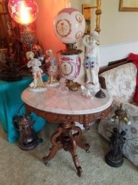 Oval Marble Top Table, Gone with the Wind Lamp. Bisque Figurines.