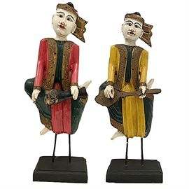 "Thai wood and polychrome musicians playing native instruments; 27"" and 26"" tall"