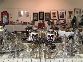 Our featured urns amidst several silver teasets and lots of silver serving pieces