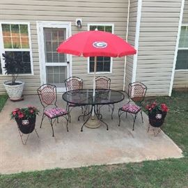 UGA Set. Stored indoors. Everything in like new. Umbrella never used. Has new iron umbrella stand now. $300.00
