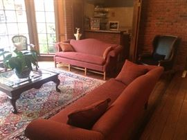 area rugs, sofa , coffee table, leather chairs , bar items