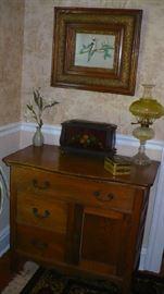 oak commode, lamp has vaseline glass shade,bird  print in beautiful oak frame
