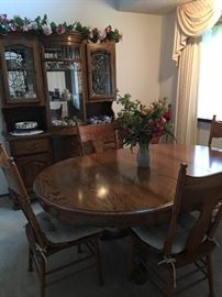 Dark wood dining table & china cabinet hutch