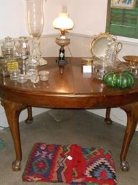 dining table, lamp, apothecaries, antique kilim
