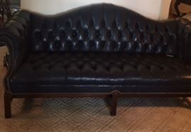 Camelback navy leather sofa