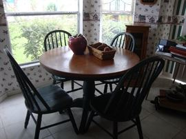 Round Oak table and 4 chairs.