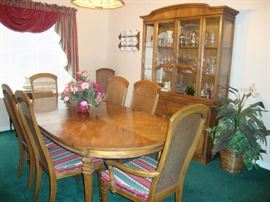 Dining table with 8 chairs/2 Captains and 2 leaves, China Hutch by United Furniture