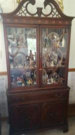 Look at the collectibles inside this beautiful China cabinet.